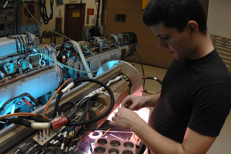EIELSON AIR FORCE BASE, Alaska -- Airman First Class Robert Wulff, Electronic Warfare Systems Apprentice, 354th Maintenance Squadron, 354th Fighter Wing, Eielson Air Force Base, Alaska, troubleshoots a high voltage power supply on an ANALQ1 84 ECM (Electronic Counter Measures) Pod here on 15 November.