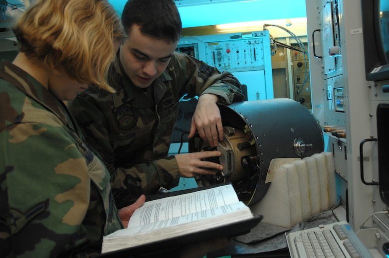 EIELSON AIR FORCE BASE, Alaska -- Airman First Class Matthew Orr and Airman Heather Mangerson, 354th Maintenance Squadron, 354th Fighter Wing, Eielson Air Force Base, Alaska, install a slip ring onto an F-16 targeting pod here on 15 November.