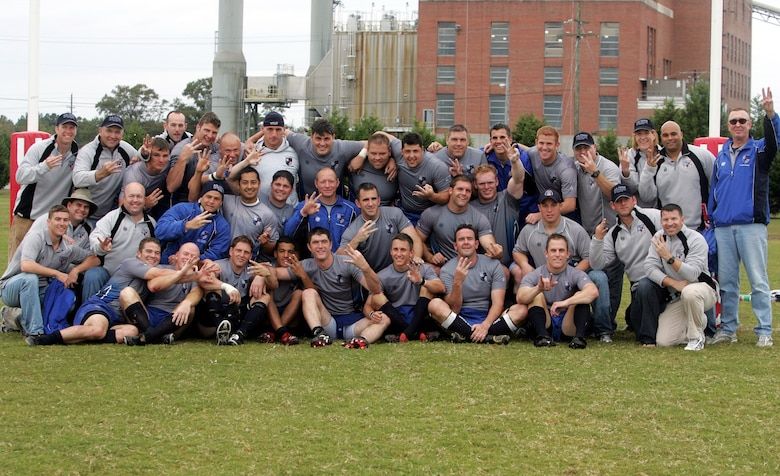 The Air Force rugby team celebrates after winning its third consecutive Armed Forces Rugby Championship tournament title.  The team was undefeated in this year's competition.  (U.S. Air Force photo/Major Scott Foley)