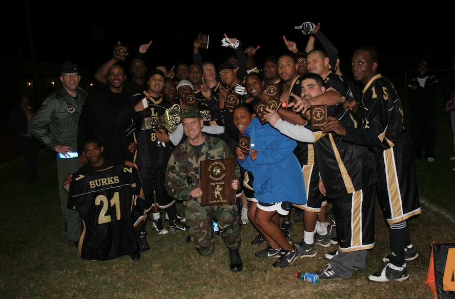Members of the 2006 Incirlik Intramural Flag Football champion 39th Logistics Readiness Squadron hold up their championship trophies after defeating the 39th Contracting Squadron/Civil Engineer Squadron team 18-12 in overtime Nov. 14. (U.S. AIr Force photo by Staff Sgt. Oshawn Jefferson)