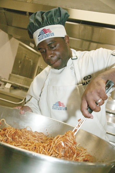 Airman 1st Class Derek Maple, 20th Services Squadron food service specialist, combines noodles and sauce to make spaghetti for the midnight meal Monday. (U.S. Air Force photo/Tarsha Storey)