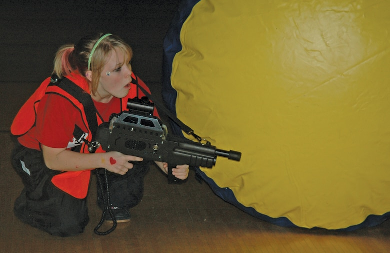 EIELSON AIR FORCE BASE, Alaska -- Brianna Presley, daughter of Tech. Sgt. Sonya Foster, 354th Contracting Squadron, tests out new laser tag equipment with peers from Ben Eielson High School Oct. 27 at the base fitness center.