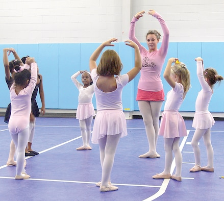 Chanel Muse teaches a group of children the basics of being a ballerina recently at the Youth Center. Several classes are offered at the Youth Center to teach children of all ages different dance styles.