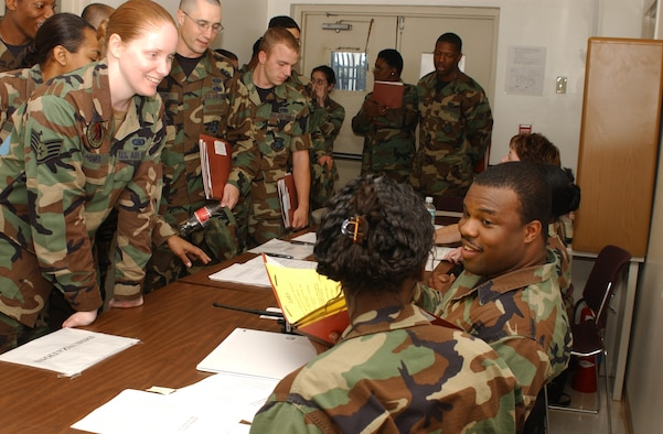 Staff Sgt. Sandra Homer, left, 81st Contracting Squadron, has her immunization records reviewed by Staff Sgt. Javon Craig, 81st Medical Operations Squadron, Nov. 7 during the 81st Training Wing's deployment exercise. (Photo by Kemberly Groue)