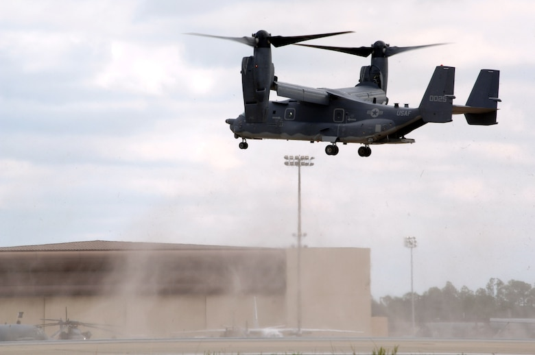 The CV-22 Osprey hovers over the Hurlburt Field, Fla., flightline during its unveiling ceremony Nov 16.  The arrival of the CV-22 to Air Force Special Operations Command is part of Hurlburt Field's Heritage to Horizon commemoration, reflecting on the heritage of air commandos, reaffirming the commitment to the war on terrorism and resolving to continually expand capabilities. The commemoration also includes marking the re-designation of the 16th Special Operations Wing to the 1st SOW and the Air Force's 60th birthday.  (U.S. Air Force photo/Senior Airman Ali E. Flisek)
