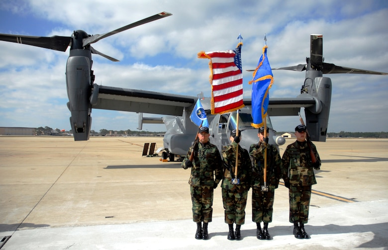 Airman 1st Class Joshua Penery (left to right), Senior Airman Cody Husemann, Airman 1st Class Jeffrey Miller and Airman 1st Class Steven Bickell, members of the 16th Special Operations Wing Honor Guard, perform in front of a CV-22 Osprey during the Air Force 60th Anniversary commemoration held at Hurlburt Field, Fla., on Nov.16.  The commemoration was marked by the arrival of the CV-22 Osprey to Hurlburt Field and the redesignation of Air Force Special Operations Command's 16th Special Operations Wing as the 1st SOW.  (U.S. Air Force photo/Chief Master Sgt. Gary Emery)