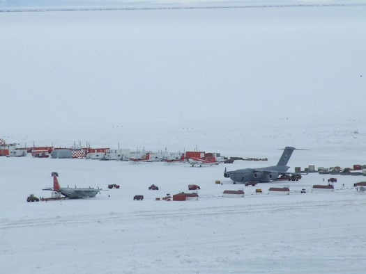 MCMURDO STATION, Antarctica - Cargo is transported from a McChord C-17 Globemaster III to an awaiting LC-130 Hercules operated by the New York Air National Guard Nov. 14, 2006, near here. U.S. Air Force Photo/ By 1st Lt Erika Yepsen