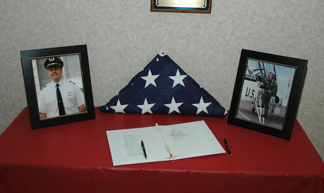 A table displaying pictures of Maj. Todd Humble was the center piece at Maj. Humble's memorial service. (Photo by Master Sgt. Tom Crawford)