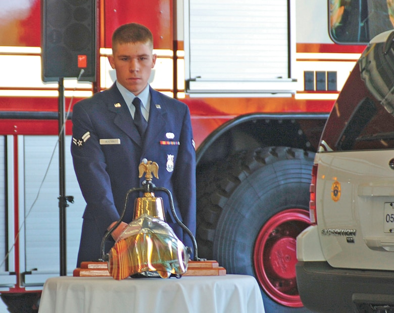Airman 1st Class Garrett Heaton, 4th Civil Engineer Squadron, rings the fire bell nine times during the new fire station?s ribboncutting ceremony Monday. Firefighters maintain traditions existing for more than 200 years and one of these traditions is the sounding of a bell.  As firefighters began their tour of duty, the bell signals the start of that day?s shift.  Throughout the day and night, each alarm was sounded by a bell, which summoned brave souls to fight fires and placed their lives in jeopardy for the good of their fellow citizen.  After the fire was out and the alarm ended, the bell signaled the completion of that call.  When a firefighter died in the line of duty, paying the supreme sacrifice, it was the mournful toll of the bell that solemnly announced a comrade's passing. These traditions reflect honor and respect to those who have given so much and who have served so well. It symbolizes the devotion that these brave souls had for their duty.  A special signal of three rings, three times each, represented the end of our comrades? duties and that they would be returning to quarters.  (U.S. Air Force photo by Senior Airman Micky Bazaldua)