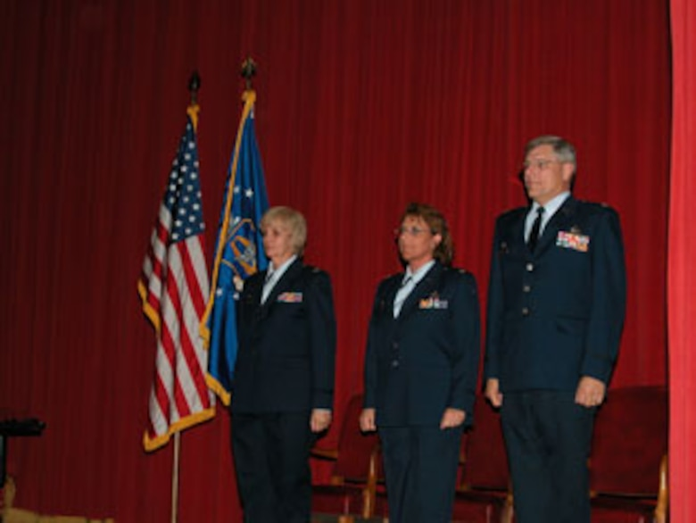 Col. Pamela LeBlanc (left) officiated the Change of Command Ceremony at March Air Reserve Base where Lt. Col. Tanya A. Porter (center) assumed command of the 56th Aerial Port squadron from Lt. Col. Laurence B. Harris (right). (USAF photo by Staff Sgt. Joe Davidson, 452 AMW Public Affairs)