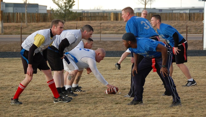 The 566th Information Operations Squadron and 460th Operations Support Squadron/2nd Space Warning System intramural flag football teams face off in the championship game Nov. 16. The 566th IOS shut out the 460th OSS/2nd SWS 13-0.