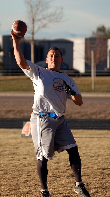 566th Information Operations Squadron quarterback Christian Moore throws a completed pass during the intramural championship football game against the 460th Operations Support Squadron/2nd Space Warning System team Nov. 16. The 566th IOS beat the 460th OSS/2nd SWS 13-0.