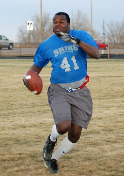 460th Operations Support Squadron/2nd Space Warning System quarterback Calvin Pennamon runs the ball during the intramural flag football game against the 566th Information Operations Squadron. The 566th IOS shut out the 460th OSS/2nd SWS 13-0.