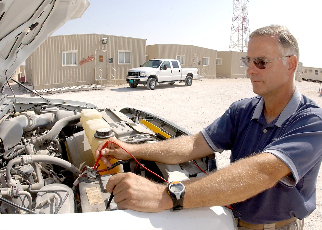 Gary Burgess tests a vehicle battery. Mr. Burgess is a vehicle maintainer for the 379th Expeditionary Security Forces Squadron. (U.S. Air Force photo/Senior Airman Ricky Best)