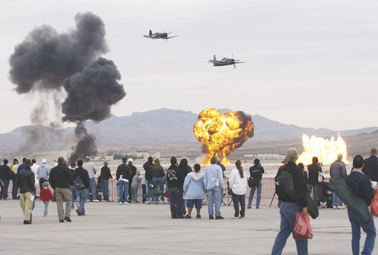The 2006 Nellis Air Force Base air show included a Korean War demonstration. Making a bombing run are an F-4U Corsair and F-8F Bearcat. (U.S. Air Force photo/Master Sgt. Kevin Gruenwald)