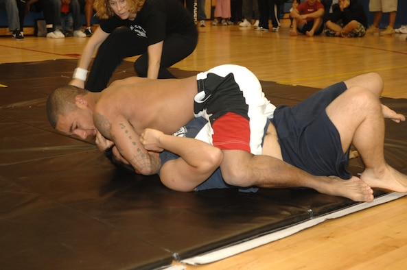 MINOT AIR FORCE BASE, N.D. -- Senior Airman Steven Jordan attempts to pin Airman Julian Pina, both from the 5th LRS, during a grappling competition at the McAdoo Sports and Fitness Center Nov. 18. Airman Jordan won the match by submission. (U.S. Air Force photo by Airman 1st Class Christopher Boitz)