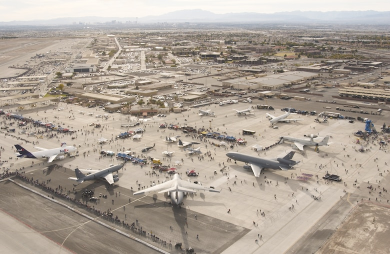 An aerial view of the Nellis flightline shows some of the more than 100 aircraft on display, as well as the city of Las Vegas on the horizon. (U.S. Air Force photo/Master Sgt. Kevin Gruenwald)