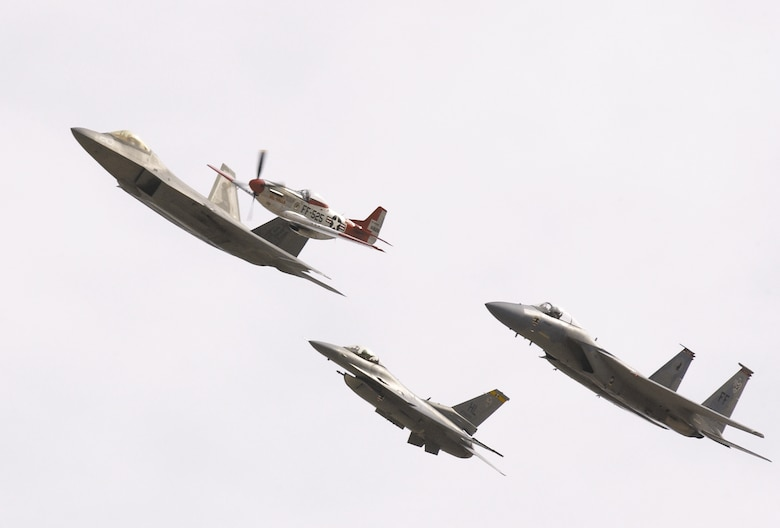 The Air Combat Command heritage flight was one of many demonstrations during the Nellis air show. The flight consists of (from top) an F-22 Raptor, P-51 Mustang, F-15 Eagle and F-16 Fighting Falcon. (U.S. Air Force photo/ Master Sgt. Kevin Gruenwald)