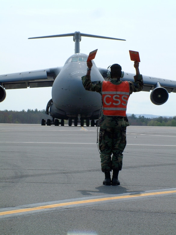 WESTOVER AIR RESERVE BASE, Mass. - A crew chief with the 439th Maintenance Group marshals a C-5 aircrew to a parking spot. The maintainers at Westover are responsible for the upkeep of 16 C-5s, the largest aircraft in the Air Force. The 439th Airlift Wing flies both the A and B models of the Galaxy, and supports Air Force strategic airlift objectives across the globe (US Air Force photo/Master Sgt. W.C. Pope).