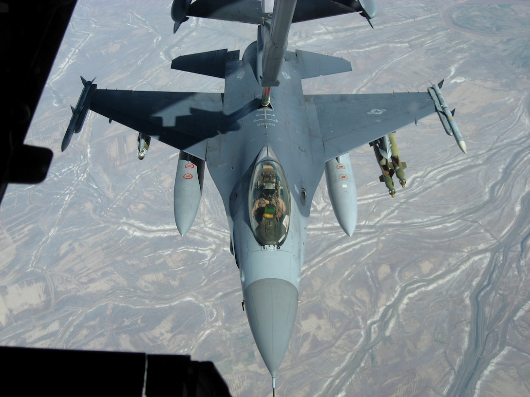 An F-16 Fighting Falcon from Balad Air Base, Iraq, takes fuel from a KC-10 Extender over Iraq Nov. 20. The KC-10 refueled two jets that afternoon in support of Operation Iraqi Freedom. The KC-10 aircrew is deployed in support of the 380th Air Expeditionary Wing. (U.S. Air Force photo/Capt. Justin T. Watson)