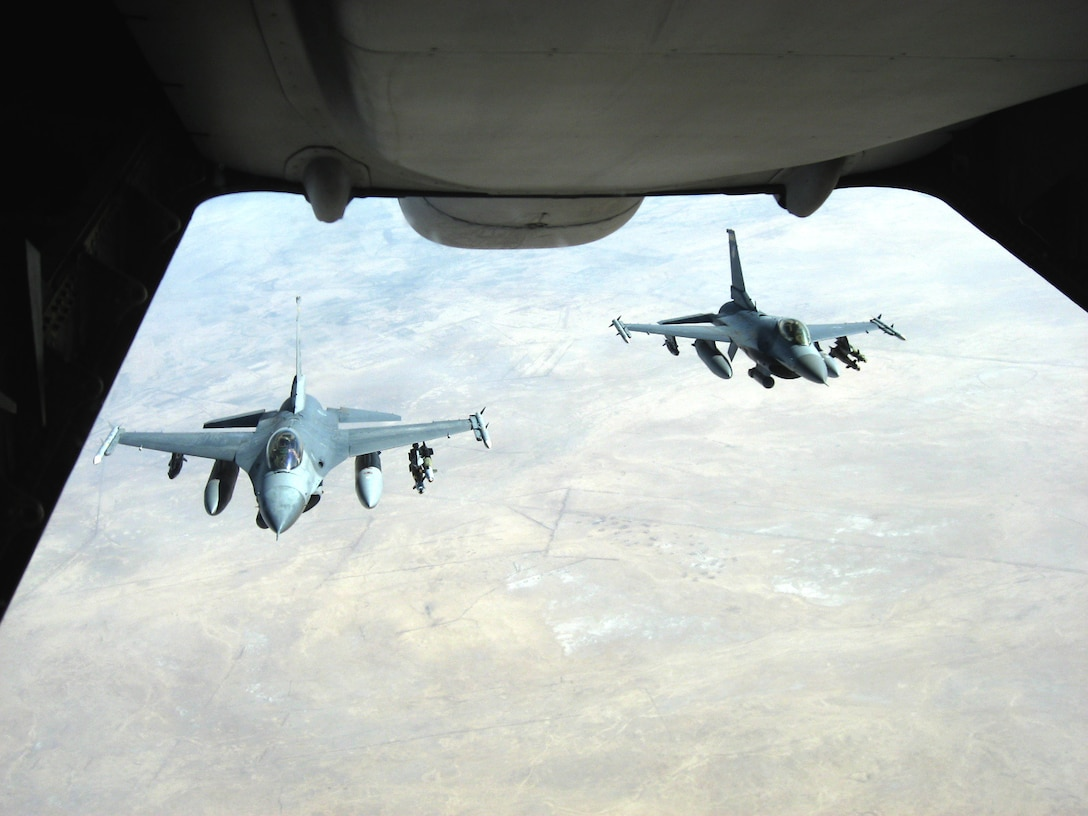 Two F-16 Fighting Falcons from Balad Air Base, Iraq, pull behind a KC-10 Extender to receive fuel before conducting a mission over Iraq Nov. 20. The KC-10 refueled both jets that afternoon in support of Operation Iraqi Freedom. The KC-10 aircrew is deployed in support of the 380th Air Expeditionary Wing. (U.S. Air Force photo/Capt. Justin T. Watson)
