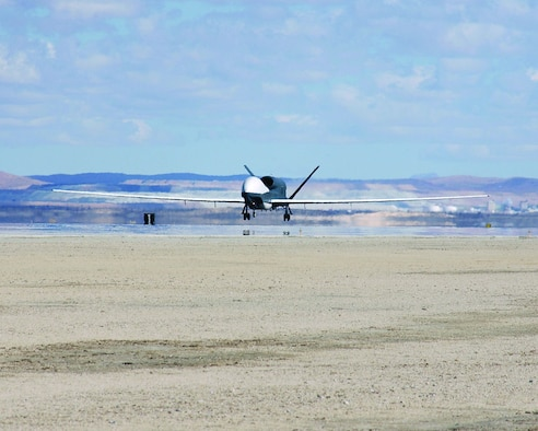 Global Hawk Unmanned Aerial Vehicle No. 3 (UAV-3) lands at Edwards on Feb. 22, 2006, after flying more than 4,800 hours in support of Operation Iraqi Freedom. (Photo by Chad Bellay)