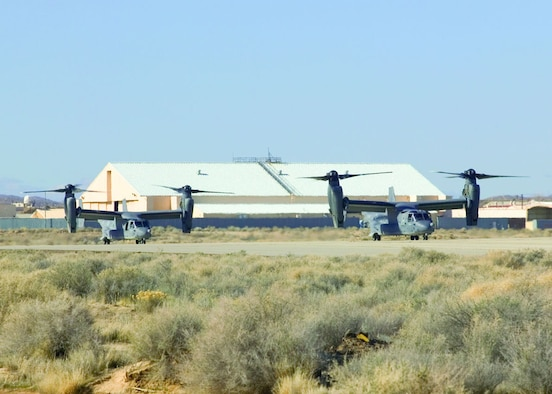 Two Air Force CV-22 Ospreys prepare for takeoff during operational training here. The CV-22 is the Air Force Special Operations variant of the V-22 Osprey tilt-rotor aircraft.   (Photo by Bobbi Zapka)