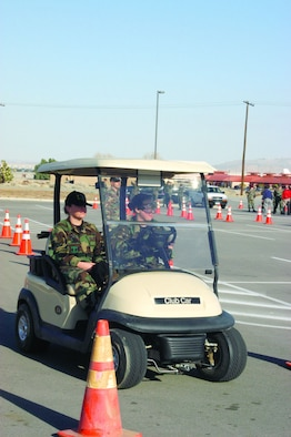 Participants of the 95th Air Base Wing's safety program simulated driving under the influence of alcohol and drugs January 26, 2006, by wearing DUI goggles and operating a golf cart. The half-day program included a safety briefing given by Col. H. Brent Baker Sr., 95th ABW vice commander, along with safety calls held by squadron commanders and DUI demonstrations throughout the afternoon. (Photo by Airman 1st Class Julius Delos Reyes)