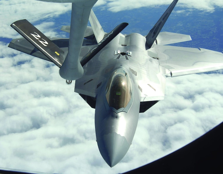 An F-22A Raptor from Langley Air Force Base, Va., refuels with a KC-135 Stratotanker from McConnell Air Force Base, Kan., during the Raptor's first operational mission Jan. 21, 2006. The mission was flown in support of Operation Noble Eagle. The KC-135 was flown by the 18th Air Refueling Squadron, while the F-22A was with the 27th Fighter Squadron.  (Photo by Master Sgt. Maurice Hessel)