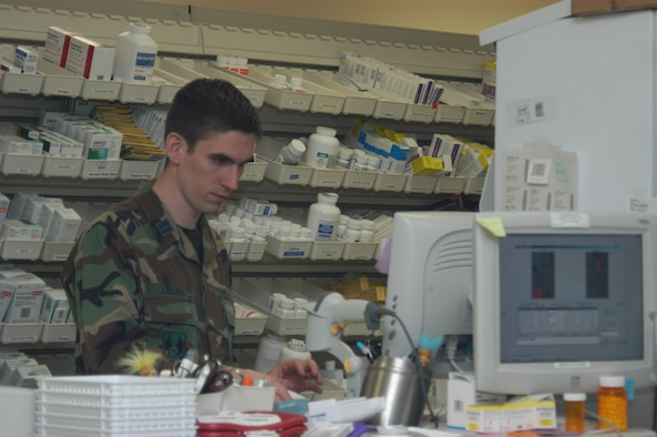 Capt. Jonathan Lehan, 95th Medical Group chief of pharmacy element, checks a prescription in the computer at the clinic here. (Photo by Airman Stacy Garcia)
