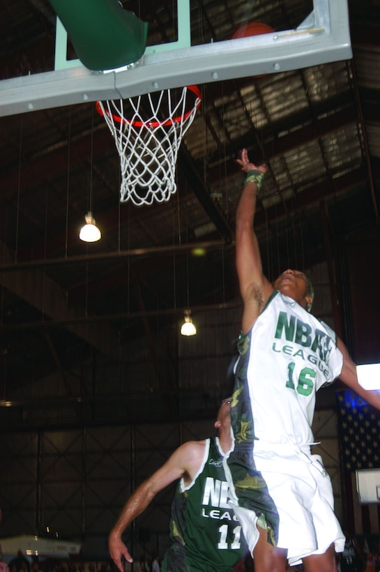"Actor Corey Hardrict, from the movie ""Crazy/Beautiful,"" does a layup during the National Basketball Association Entertainment League game here June 17, 2006.  Mr. Hardrict represented the 95th Air Base Wing Strikers team.  Striker team defeated the 412th Test Wing Fighter team, 88-77. (Photo by Airman Stacy Garcia)"