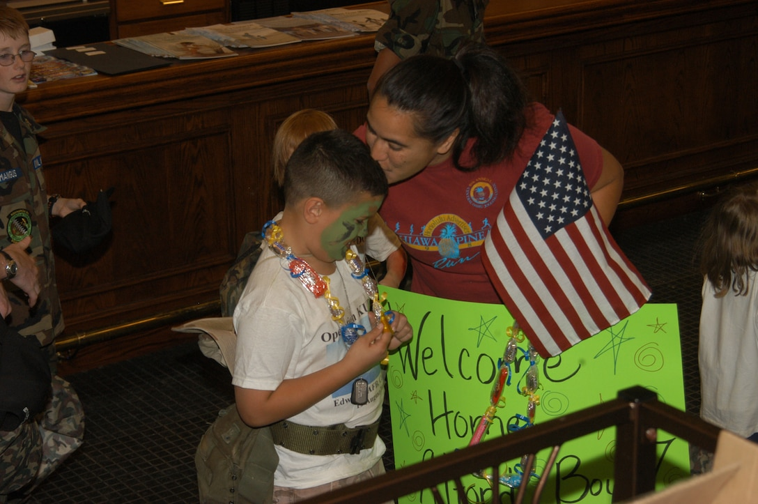 Lupe Alford welcomes home her son Elijah Alford, 7, from his mock deployment at Camp Raven.  (Photo by Airman Stacy Garcia)