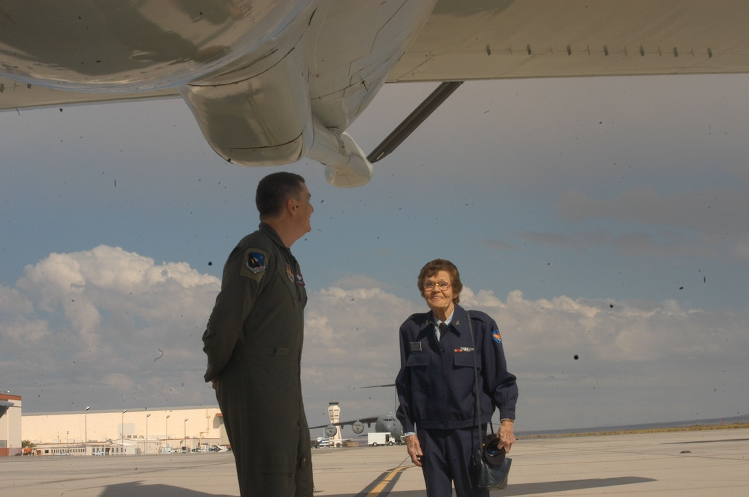 Master Sgt. Craig Eyre, 445th Flight Test Squadron, shows Margueritte Hughes Killen, former Women's Airforce Service Pilot, the KC-135 Stratotanker. (Photo by Airman Stacy Garcia)