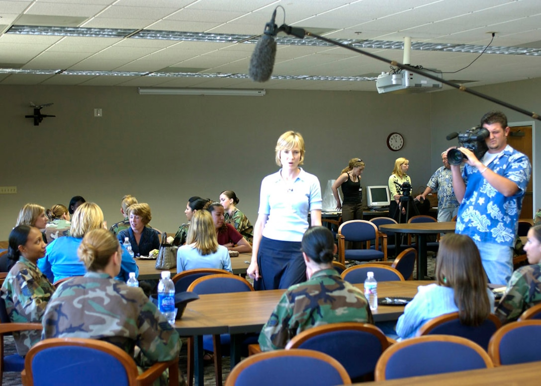 Willow Bay (left), journalist, talks with military women and military wives here as part of a documentary for the Lifetime television network Monday.  (Photo by Senior Airman Francesca Carrano)