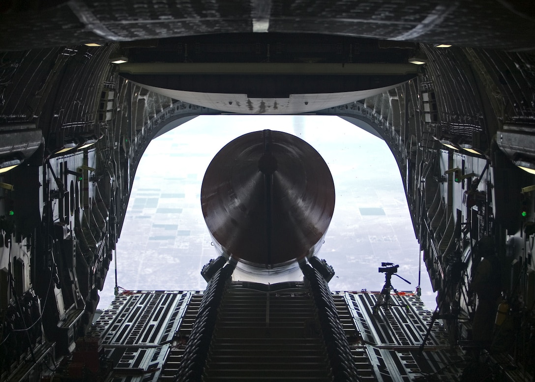 A 65-foot, 72,000-pound booster rocket mock-up exits the cargo bay of a C-17 Globemaster III July 26, 2006. The airdrop was the final test in phase 2B of the Falcon small launch vehicle program, a joint effort between Defense Advanced Research Projects Agency and the Air Force to develop a more flexible and low-cost method of putting a 1,000-pound satellite into low earth orbit. This was the longest and heaviest single item ever dropped from a C-17. (Photo by Steve Zapka)
