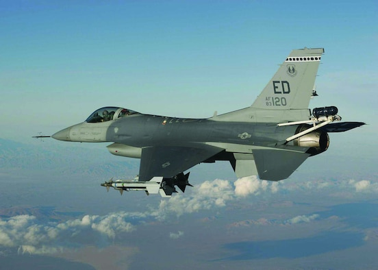 """An F-16 from the 416th Flight Test Squadron tests a replacement pylon designed to carry towed decoys for the Taiwan Air Force. The Taiwan High Angle of Attack program was rolled into Edwards' Operational Readiness Exercise, Feb. 27 through March 3, 2006, to prove the squadron's capability to """"test surge"""" in support of real-world Global War on Terror requirements.  (Photo by Tom Reynolds)"""