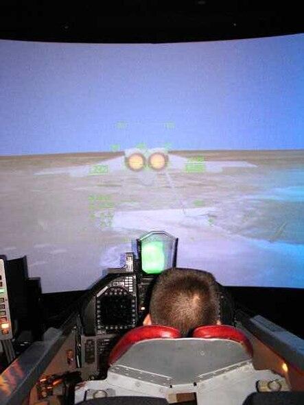 CAP Airman Basic A.J. Lafferty experiences what it's like to fly an F-18 as he pilots NASA's flight simulator during his visit here. (Photo by Civil Air Patrol Maj. Jason Markiewitz)