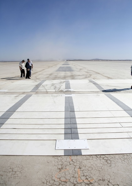 Airfield Management personnel checked for proper placement of custom designed ramps for the C-5 landing gear tests. The C-5 Galaxy completed a series of high and low-speed taxi tests on the ramps here Aug. 9, 2006.  (Photo by Jet Fabara)