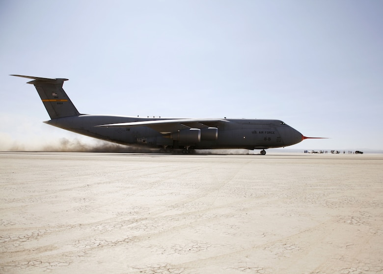 A C-5 Galaxy taxis across a series of ramps on Rogers Dry Lakebed here Aug. 2, 2006, as part of the C-5's Reliability Enhancement and Re-Engining Program. The dynamic tests are designed to evaluate the structural modes of the aircraft with newer CF6 jet engines installed.  (Photo by Jet Fabara)