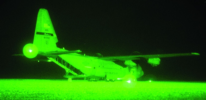A C-130J as seen through night-vision goggles during Phase 2 testing.  (Courtesy photo)