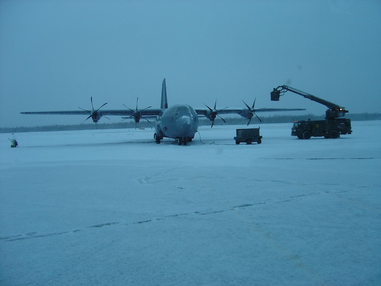 A C-130J is de-iced at Eielson Air Force Base, Alaska, during Phase 2 Operational Test and Evaluation flight test studies. The deployment of the C-130J to Eielson was designed to test the aircraft and its avionics' ability to continue its mission through extreme weather conditions. (Photo by 1st Lt. Thomas Harner)