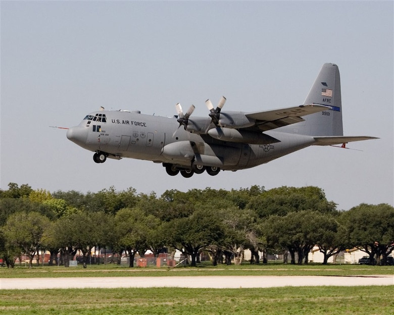 The first C-130 Avionics Modernization Program aircraft lifts off the runway at Lackland Air Force Base, Texas, on its maiden flight Sept. 19, 2006.  (Photo by Rich Rau)