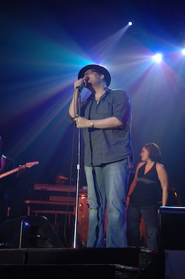 John Popper of the platinum-selling group, Blues Traveler, sings to more than 500 members of Team Incirlik during the Operation Season's Greetings concert Nov. 22 at Incirlik Air Base. The OSG Tour made its first stop at Incirlik bringing country music artist Jamie O'Neal, entertainer of the air waves Delilah, John Popper of Blues Traveler, the New England Patriots cheerleaders and the U.S. Air Forces in Europe and Reserve bands. (U.S. Air Force photo by Airman 1st Class Nathan Lipscomb)