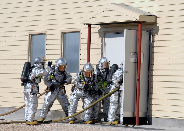 Incirlik Air Base firefighters from Engine 12 and Engine 13 begin to enter the fire training facility while responding to a call during an exercise, 20 November. The fire training facility is designed for Incirlik firefighters to conduct exercises and can reach temperatures as high as 1,200 degrees Fahrenheit. (U.S. Air Force photo by Airman Kelly LeGuillon)