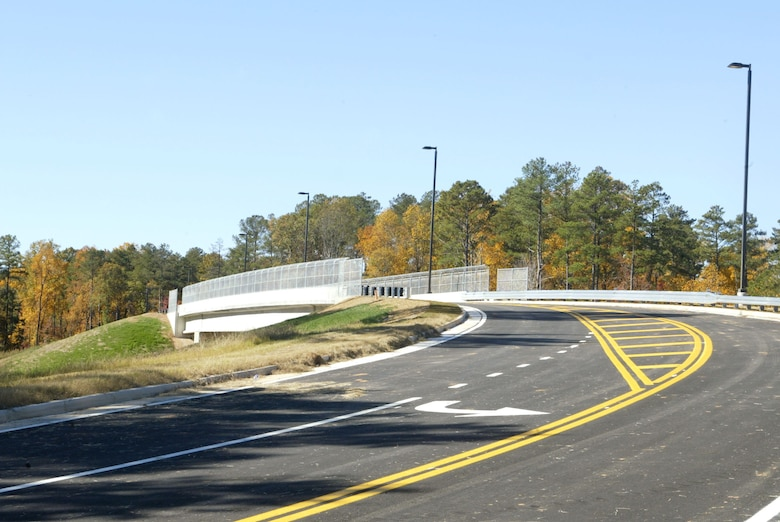 The planning and building of the 6,000 foot bridge took two years from start to finish. Construction started with a simple clearing of the land to its completed stage of 4,860 feet of sidewalk and its 220 feet long 40 feet wide massive overpass at completion. The bridge which crosses over South Cobb Drive will cut down on some of the traffic problems at the main gate of Dobbins ARB.