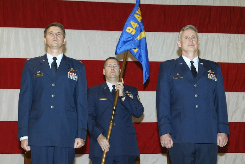 Col. Heath Nuckolls, 94th Airlift Wing commander, left, presents command of the 94th Operations Group to Col. Steve Clayton, right, during an official assumption of command ceremony here Nov. 5.