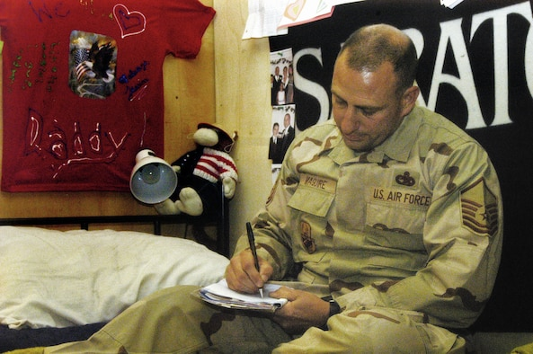 BAGRAM AIR BASE, Afghanistan -- Master Sgt. Timothy Maguire, an Air Force reservist from Westover, writes a letter to his family while deployed thousands of miles from home (US Air Force photo/Capt. Vince King).