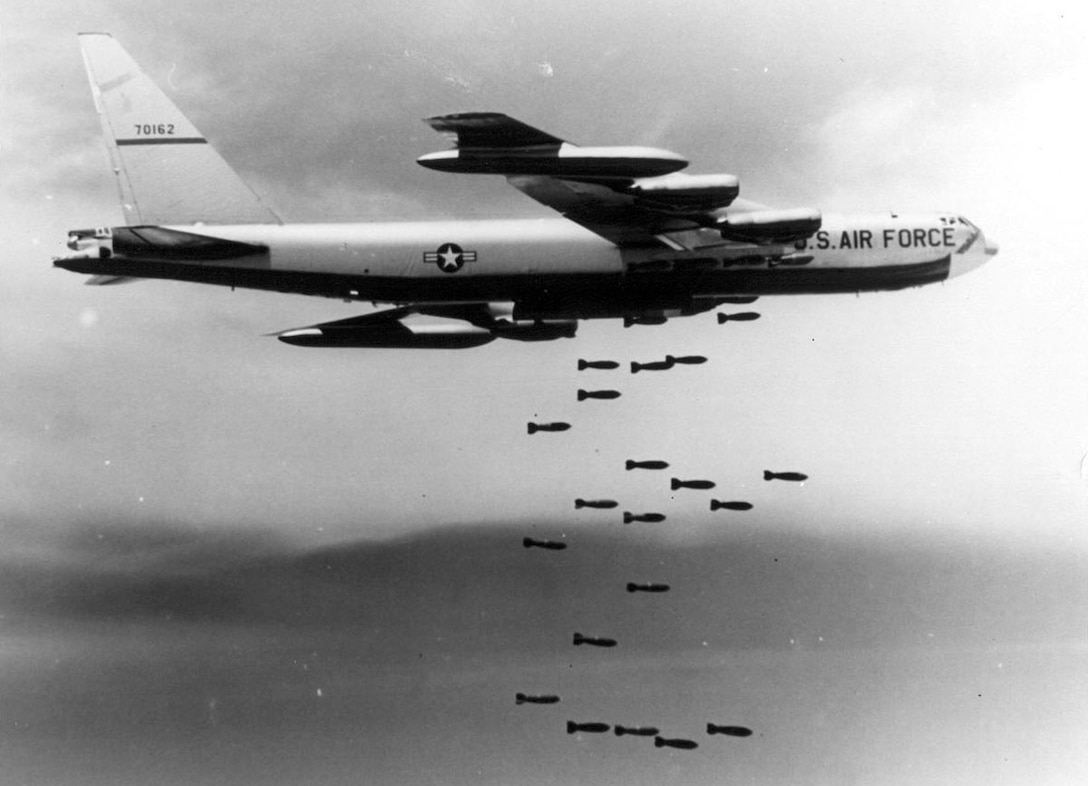 Boeing B-52F-70-BW (S/N 57-0162) in flight dropping bombs. (U.S. Air Force photo)