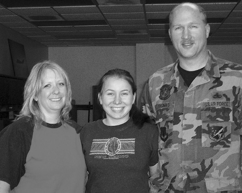 "Katya, a Russian foreigh exchange student, and her ""parents-away-from-home,"" Ms. Kelly Thomas and Master Sgt. Lewis Thomas. Katya has been in the U.S. since August with the FLEX program."