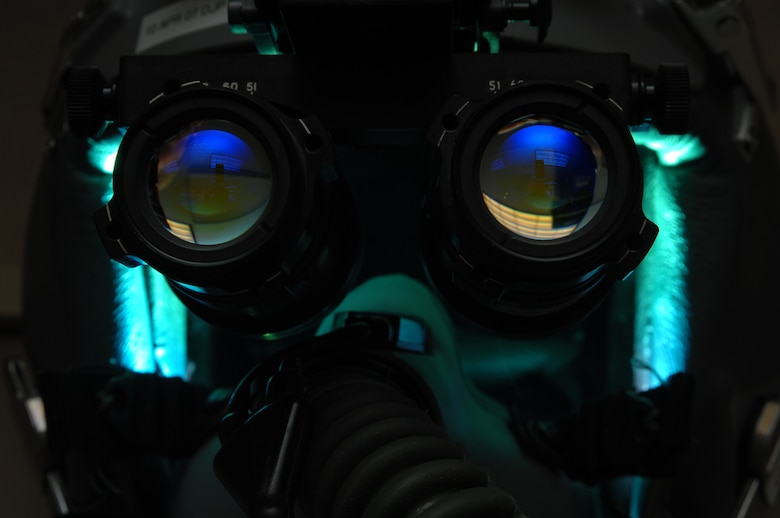 EIELSON AIR FORCE BASE, Alaska -- AN/AVS-9 Night Vision Goggles (NVG's) sit atop a fighter pilot's helmet in the Life Support Section of the 355th Fighter Squadron here on 29 Nov. During the winter months pilots of Eielson Air Force Base, Alaska are given a greater opportunity to train with NVG's more than their counterparts in the lower 48 states due to the decrease length of sunlight. (U.S. Air Force Photo by Staff Sgt Joshua Strang)